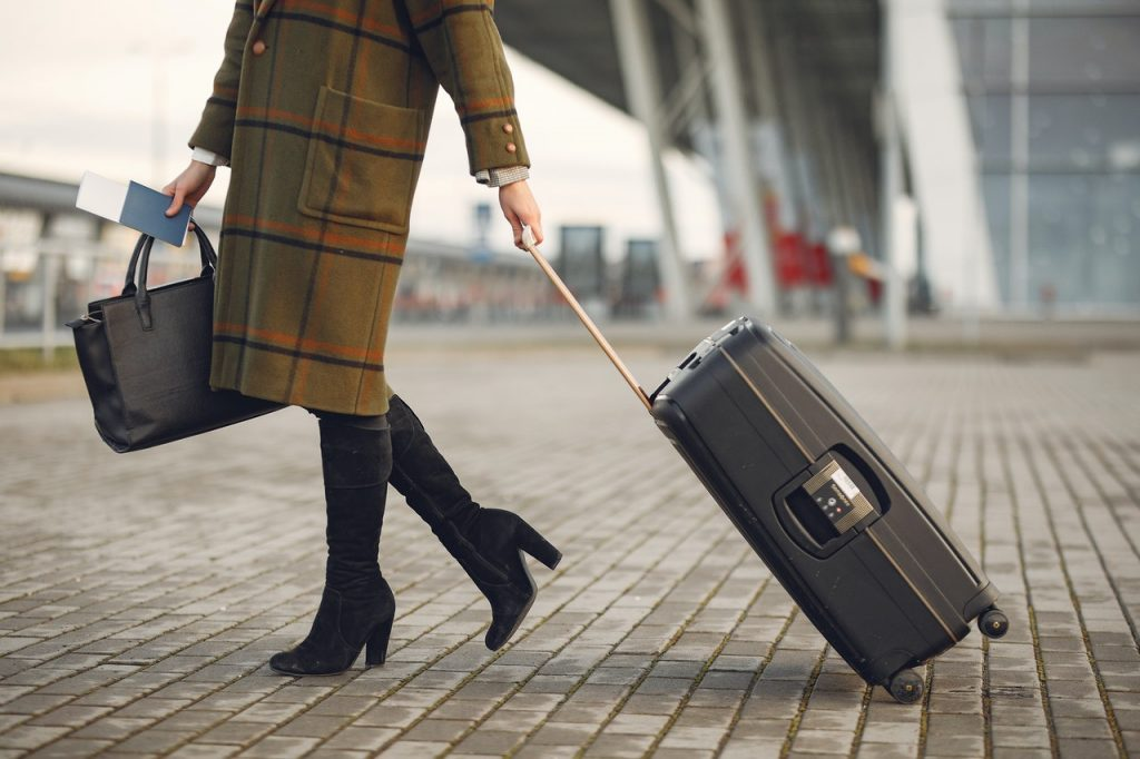 girl with suitcase traveling