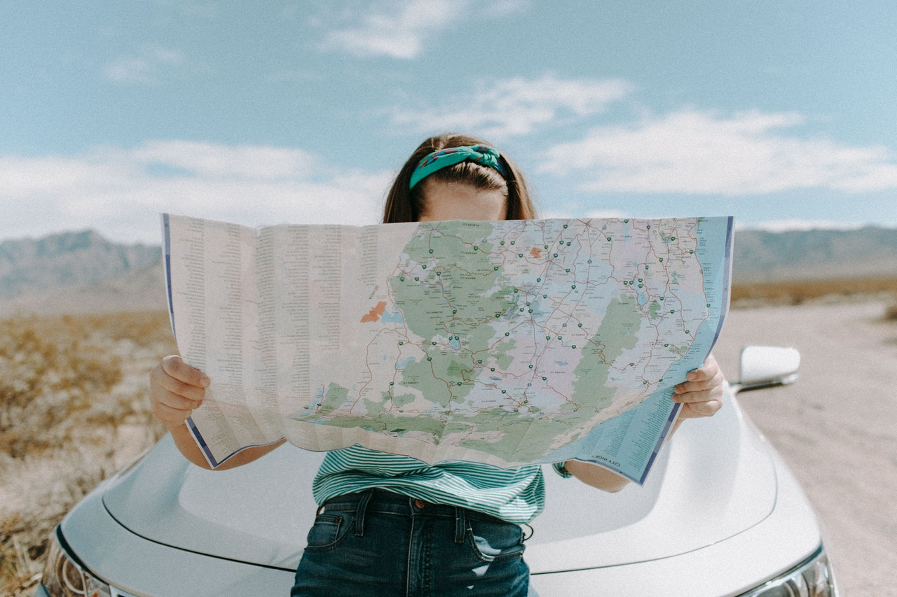 girl with road map going on a weekend get-away