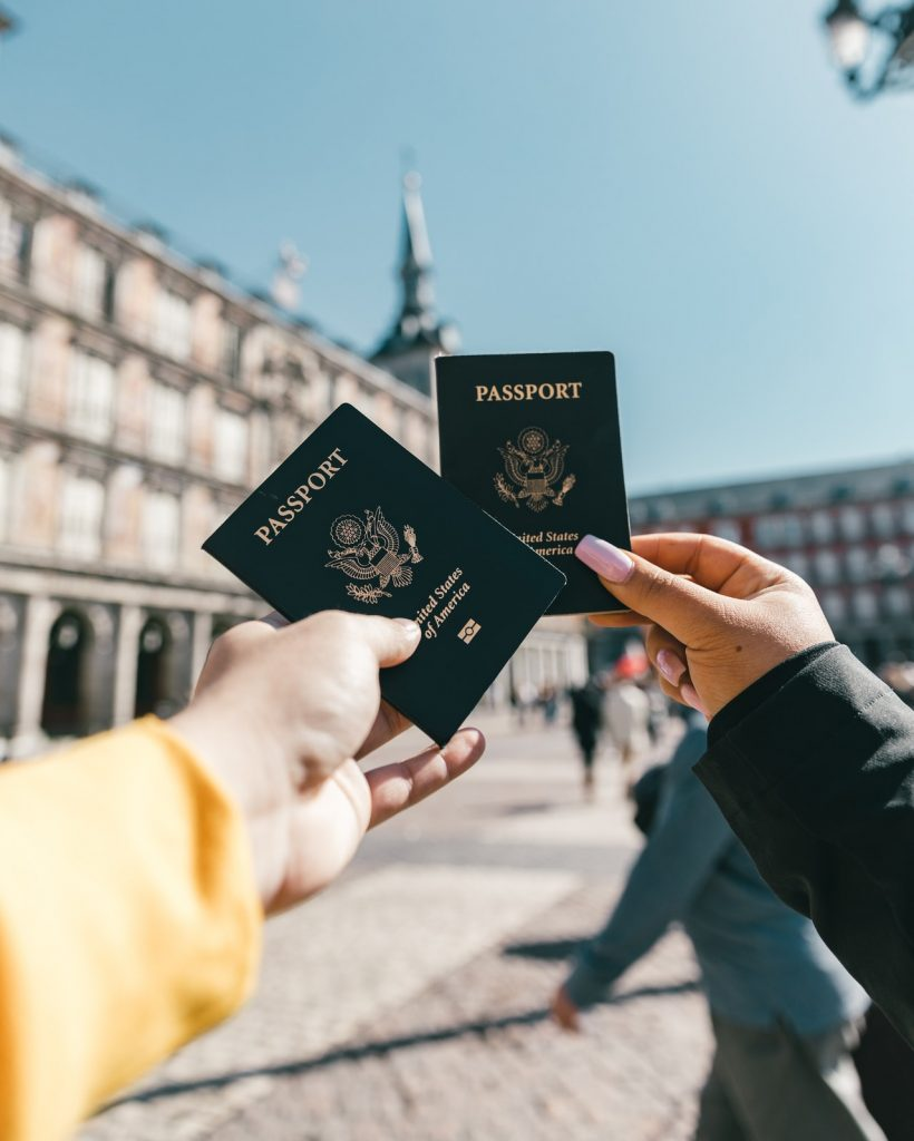 two people holding passports